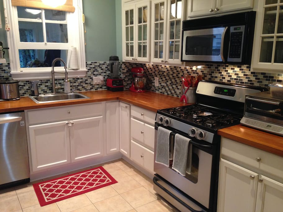 Updated kitchen with gas range, microwave, dishwasher, convection oven, garbage disposal
