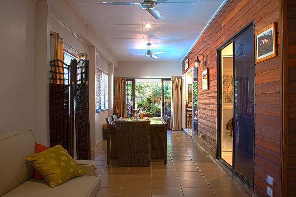 Formal dining leading to verandah from guest lounge