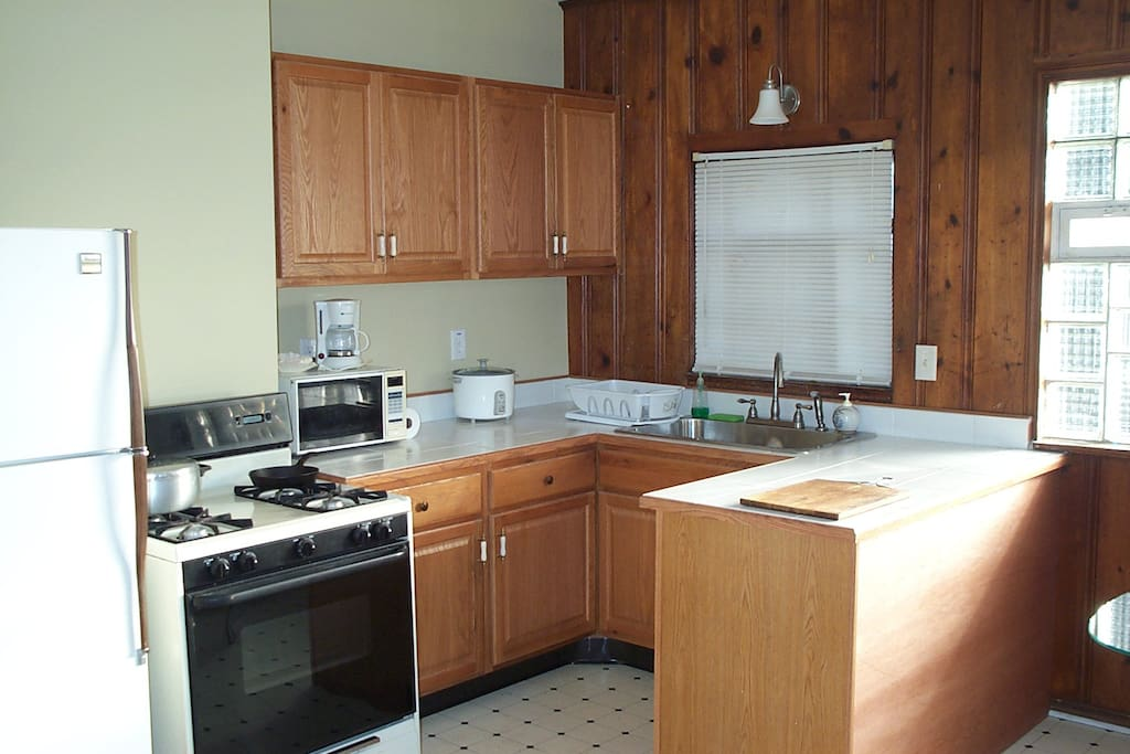 The kitchen / dining area has a gas stove/oven & refrigerator/freezer.