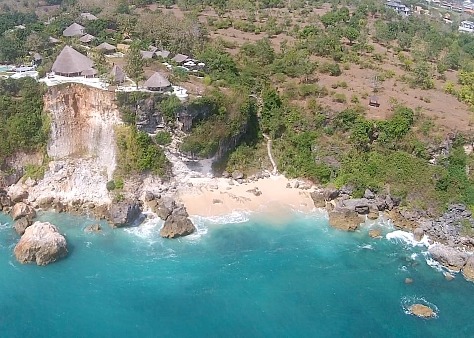Drone photo showing the villa and beach below.