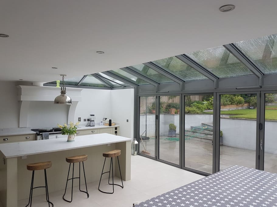 Beautiful, bright and modern kitchen with all possible mod cons. Dining area seats 12.