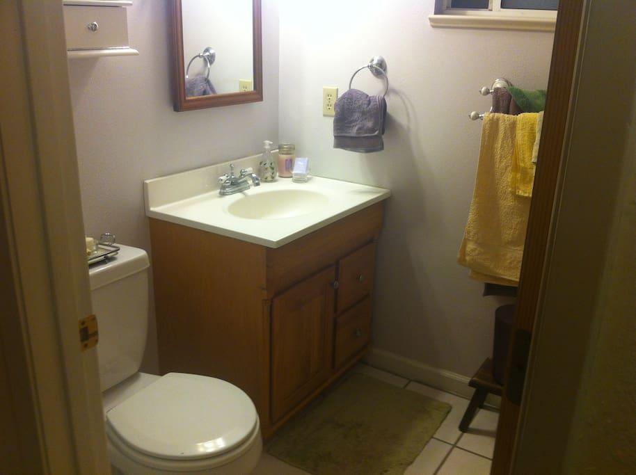 Bathroom w/tub shower is shared.