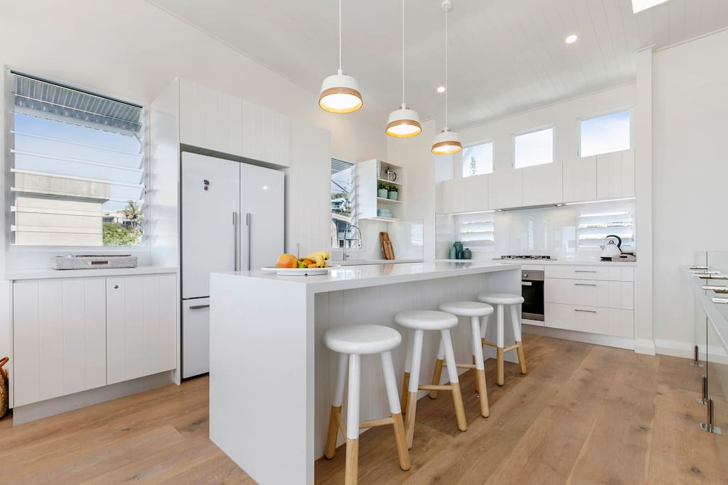 Open plan kitchen with quality appliances
