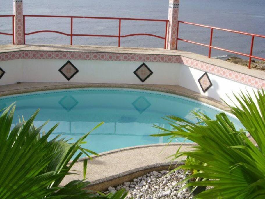 Swimming pool nestled on the beach shoreline