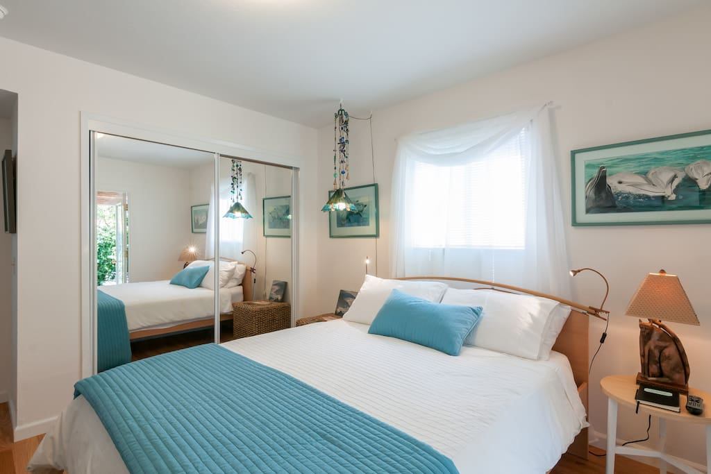 Well lit room with a comfortable bed and memory foam mattress.