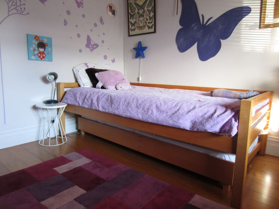 Kids bedroom with king single and rollout bed.  Plenty of wardrobe space.