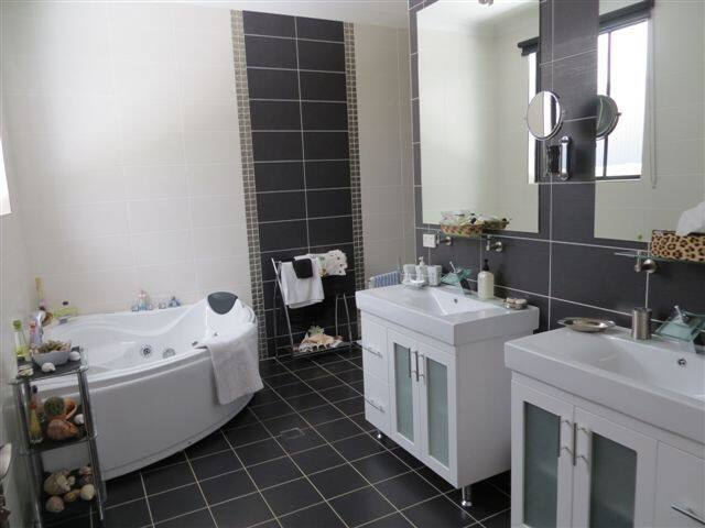 ensuite with spa bath, large shower,double basin