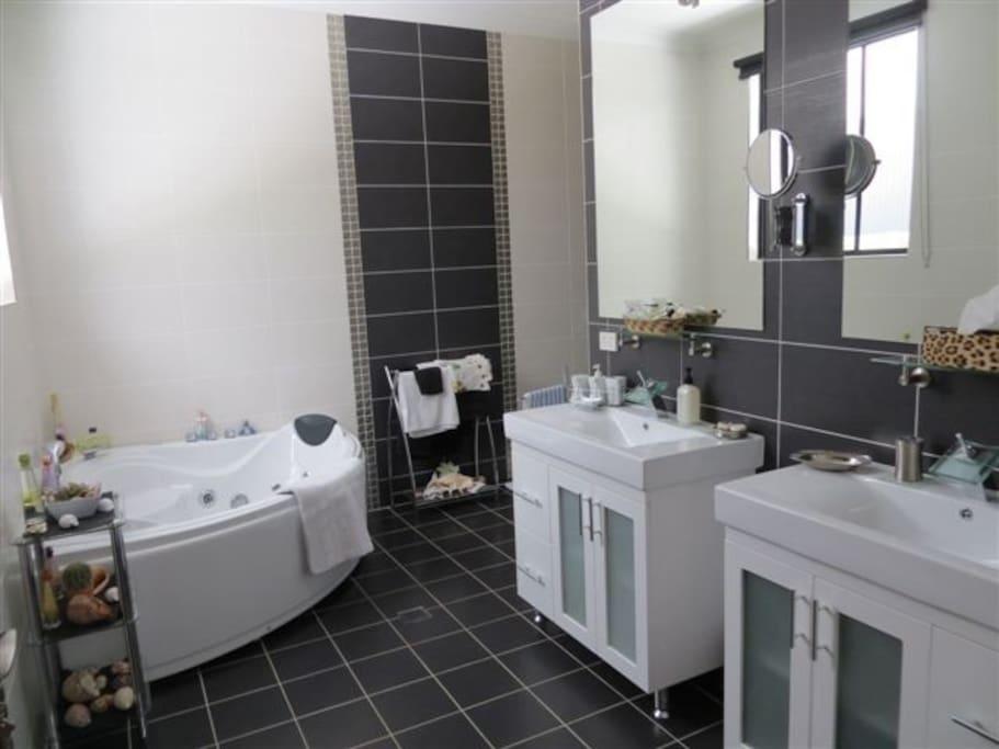 ensuite with spa bath, large shower,double basin