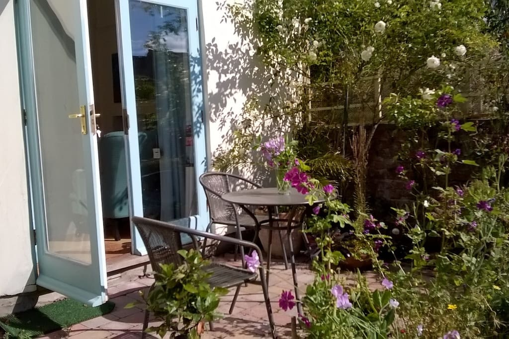 Kitchen leads out onto patio and garden sunny. garden