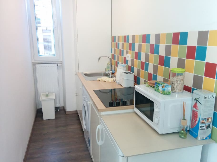 Kitchen with all necessities, microwave, toaster, kettle, fridge, stove etc.