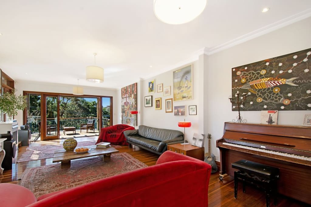 Open Plan living area with large north facing sun drenched balcony overlooking Bronte Park and Beach