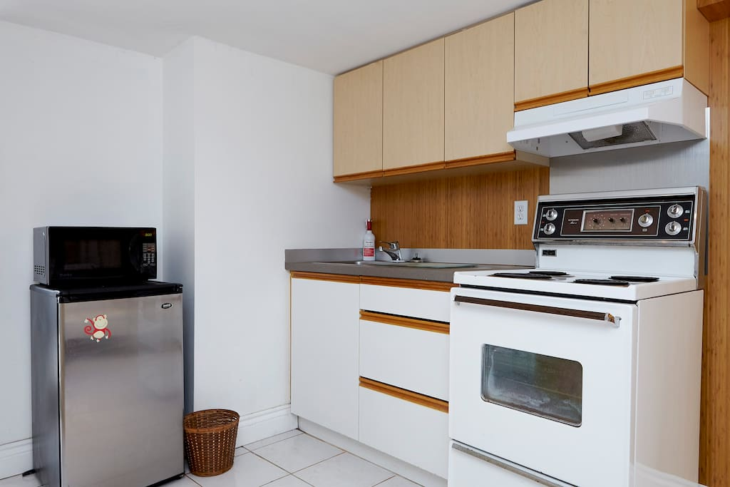 Kitchenette has a small 4 burner stove with oven and small bar fridge