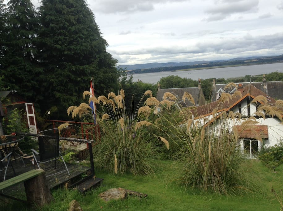 The view from the summerhouse overlooking the Firth of Forth and the Ochils Our house is the red tiled roof