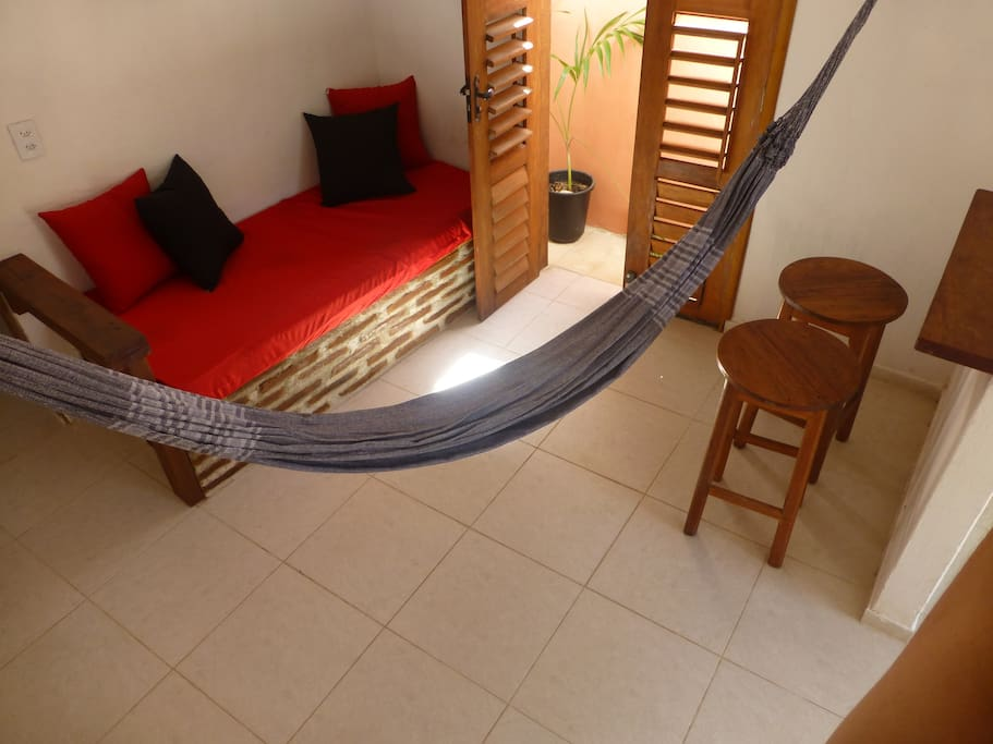 lounge area with hammock and sofa that sleeps 1