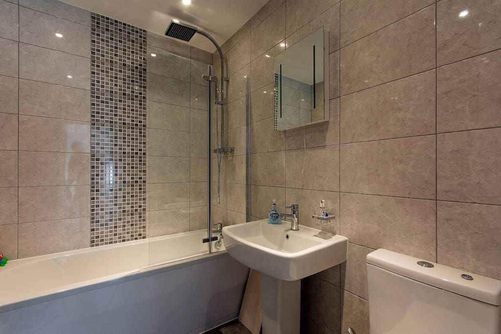 Newly refurbished, shower/bath, light in mirror, heated towel rail.