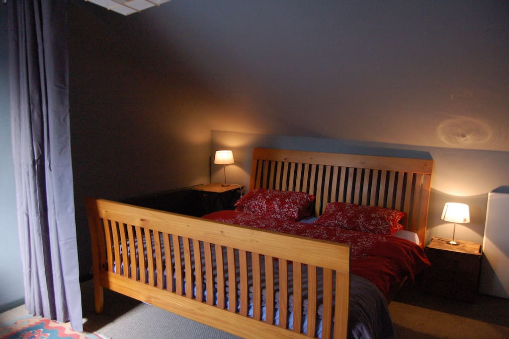 The double bed in the attic room , the curtain pulls across to divide the room. The room could sleep 5 put it would be a little tight...