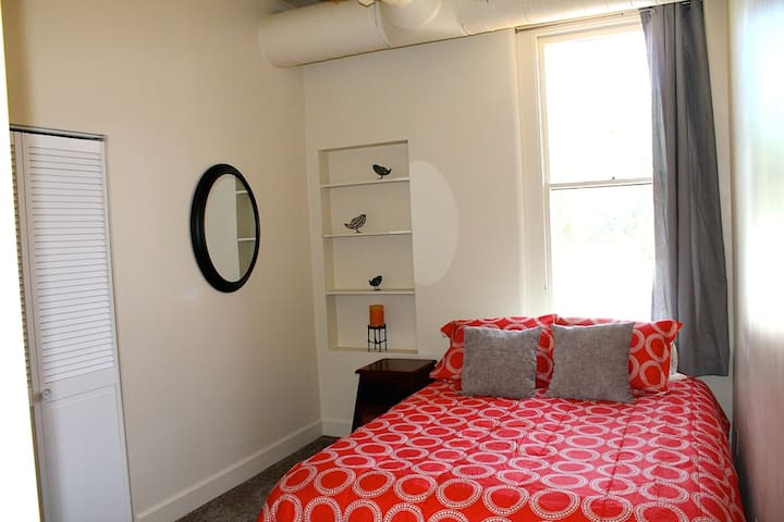 Guest bedroom with Queen bed overlooking Old Town Square