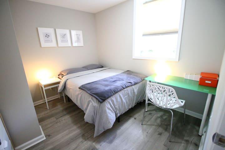 Bedroom 2 with full-sized bed, work desk, dresser, closet