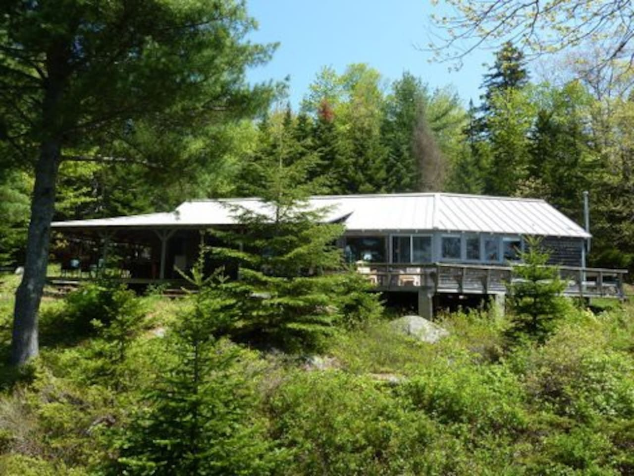 """View of the front of the house from standing on huge boulder left over from glaciation - """"Bears Den Rock""""."""