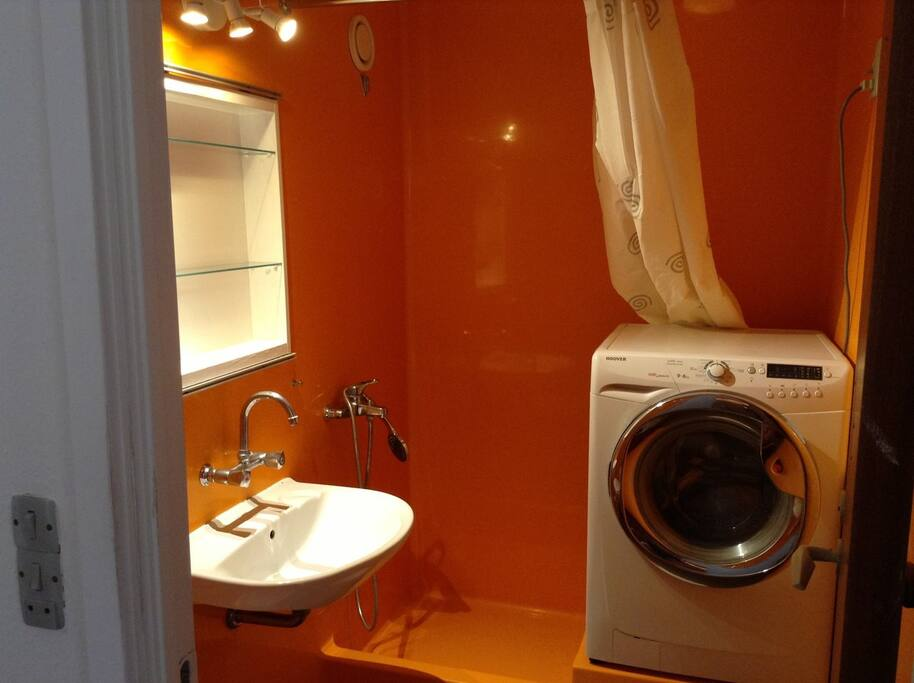 Bathroom with a shower and washing machine