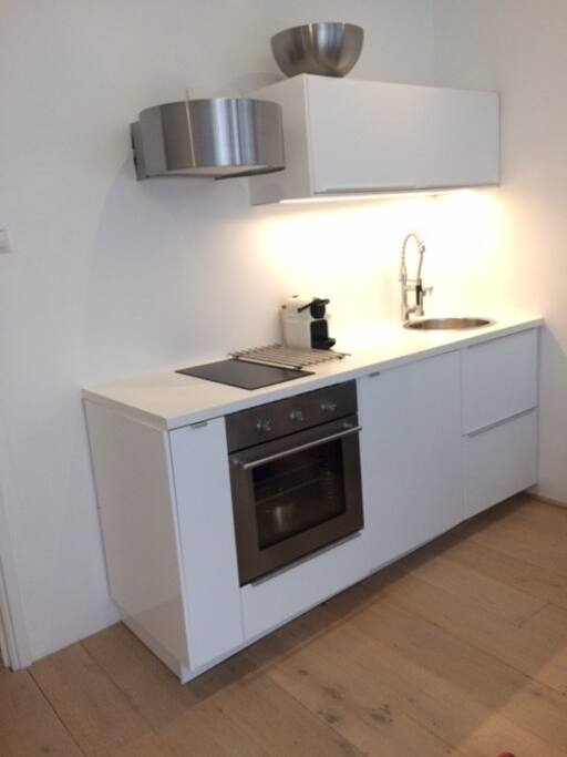 New kitchen fully equipped with oven, microwave, fridge and nespresso machine