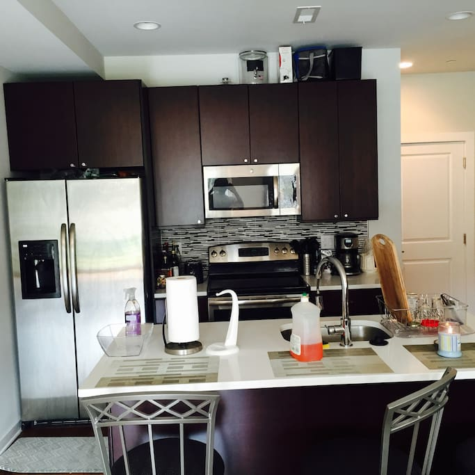 Full kitchen with spacious fridge, oven, stop top, microwave, and dish washer.