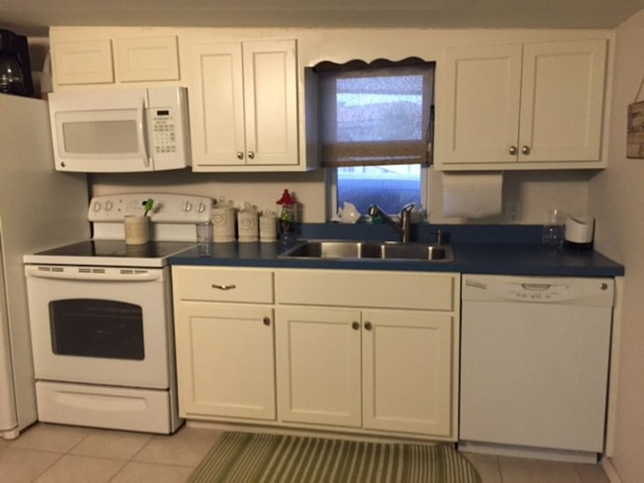Dish Washer Modern Kitchen , all utensils and dishes are ready for use.