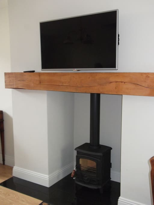 Solid fuel fireplace, Pull-out wall mounted T.V.
