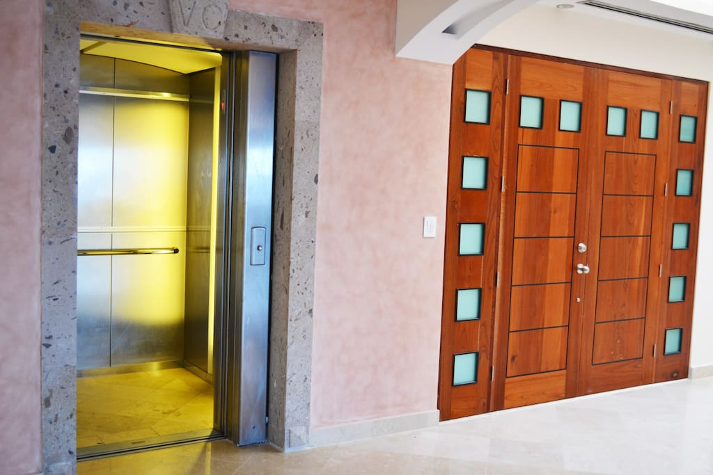 Private elevator opens right into the living room.