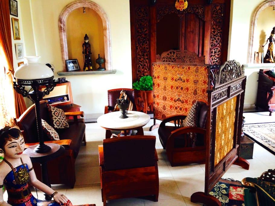guest lounge area set amongst antiques of Java