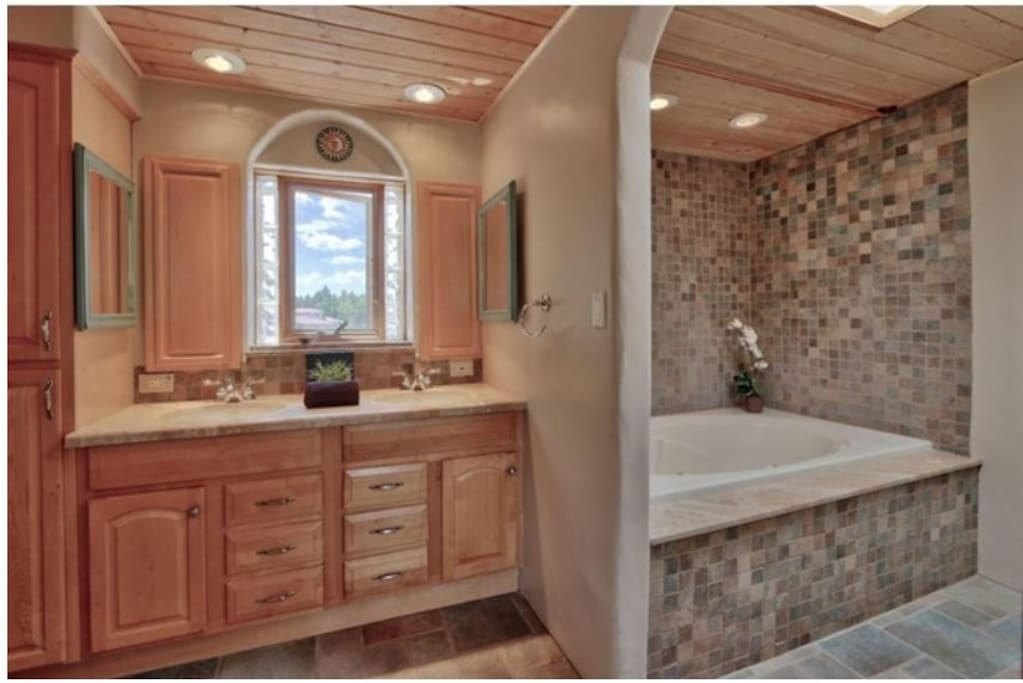 Upstairs Master Bath with 6 ft. jetted tub.