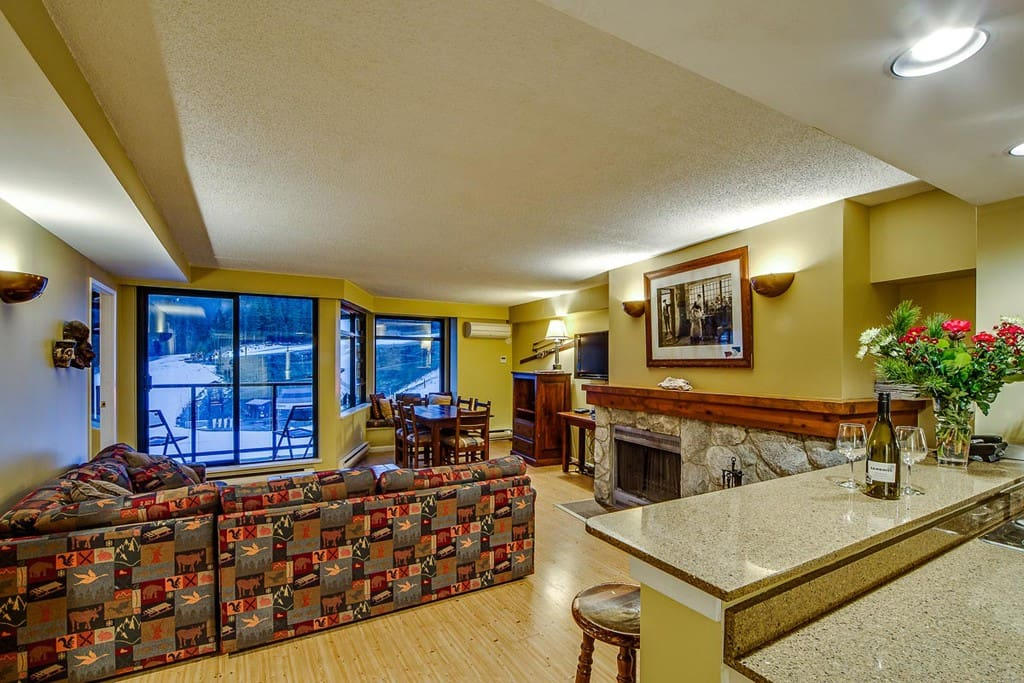 Living area with wood burning fireplace and Dining area with view of Whistler mountain