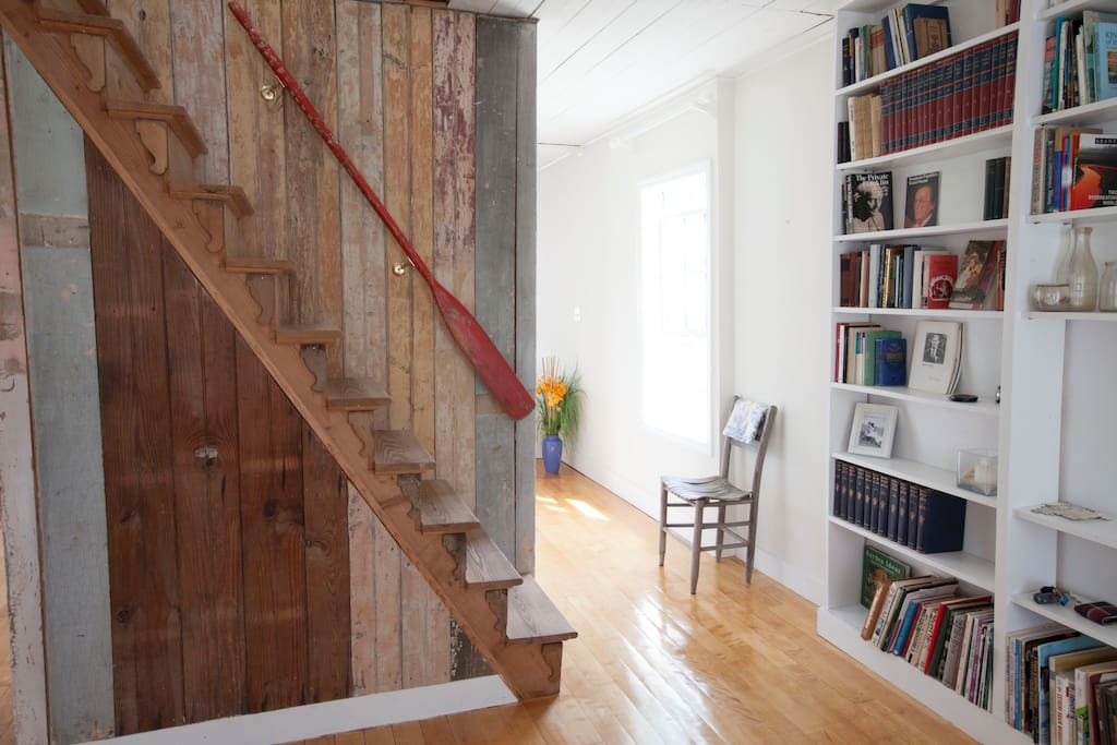 A view from the entryway with an oar for an arm rail.