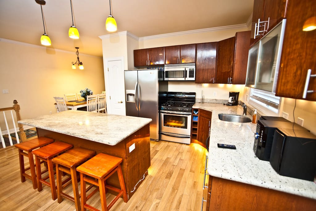 Gourmet Kitchen with Granit Counter Tops and Beautiful Lighting!