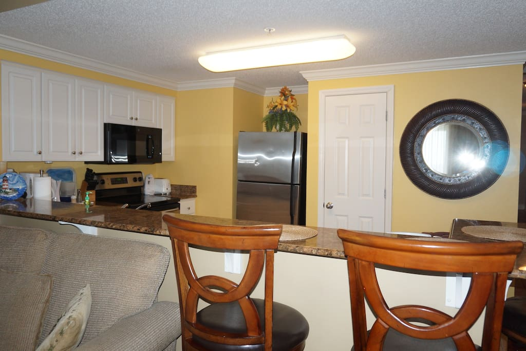 Open layout from living room into kitchen.