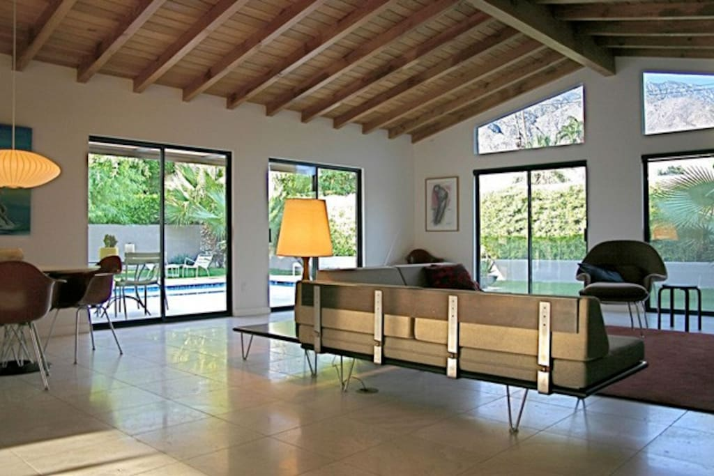 Spacious living room/grand room with dining area, facing the pool and mountains. Spectacular views!
