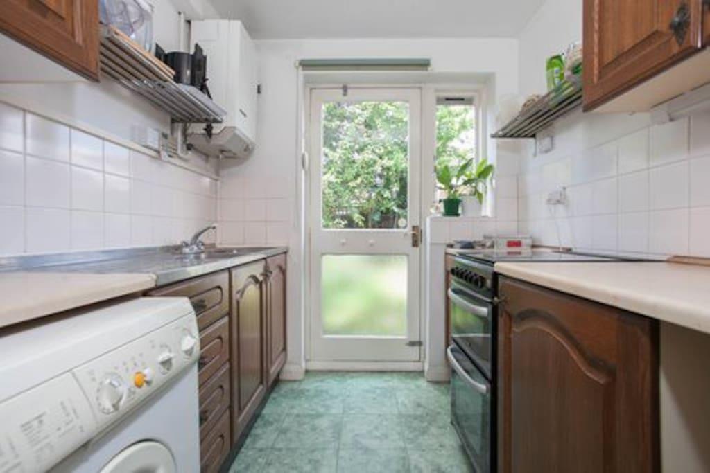 Kitchen with door to back garden