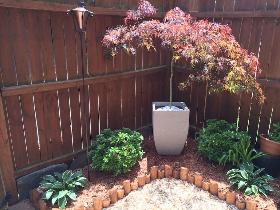 Private patio with mature plantings.