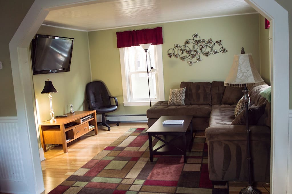 Living room with wall mounted 48 inch flat screen T.V with cable package.