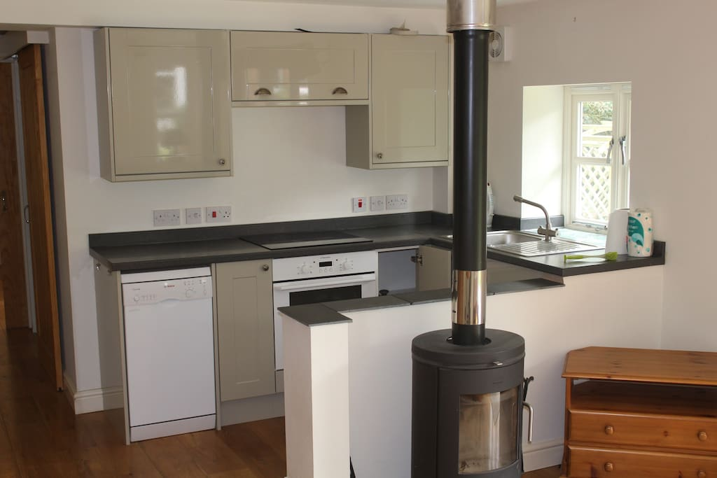 Wood burning stove and kitchen area