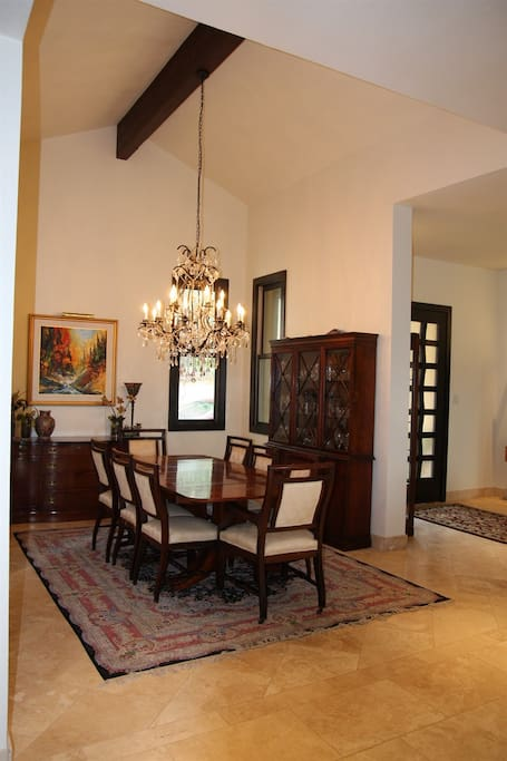 Formal Dining room with vaulted ceiling with cedar beam.