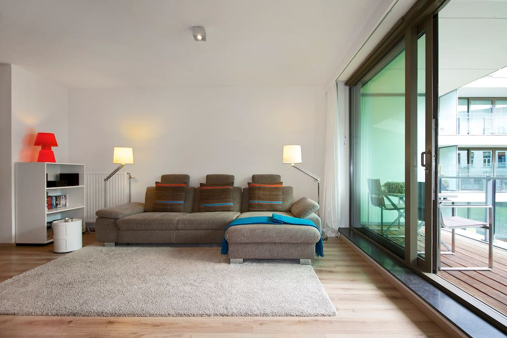 Hugh comfortable couch and sliding door to terrace