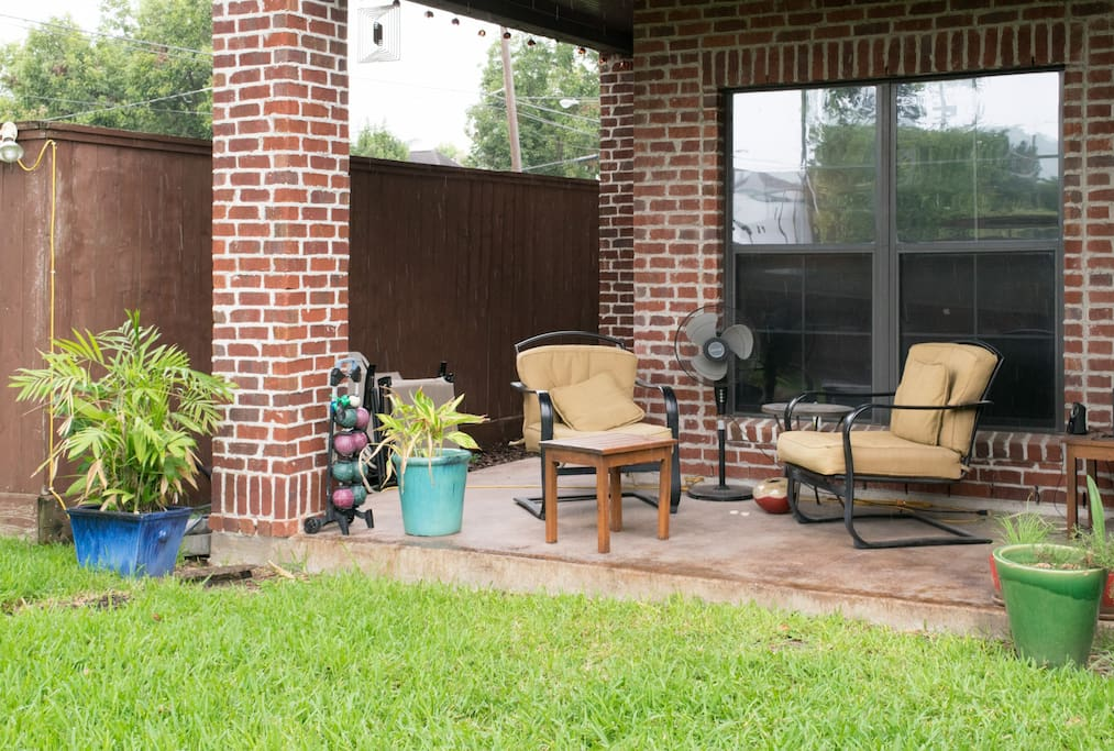 Comfortable seating and games on the first level patio