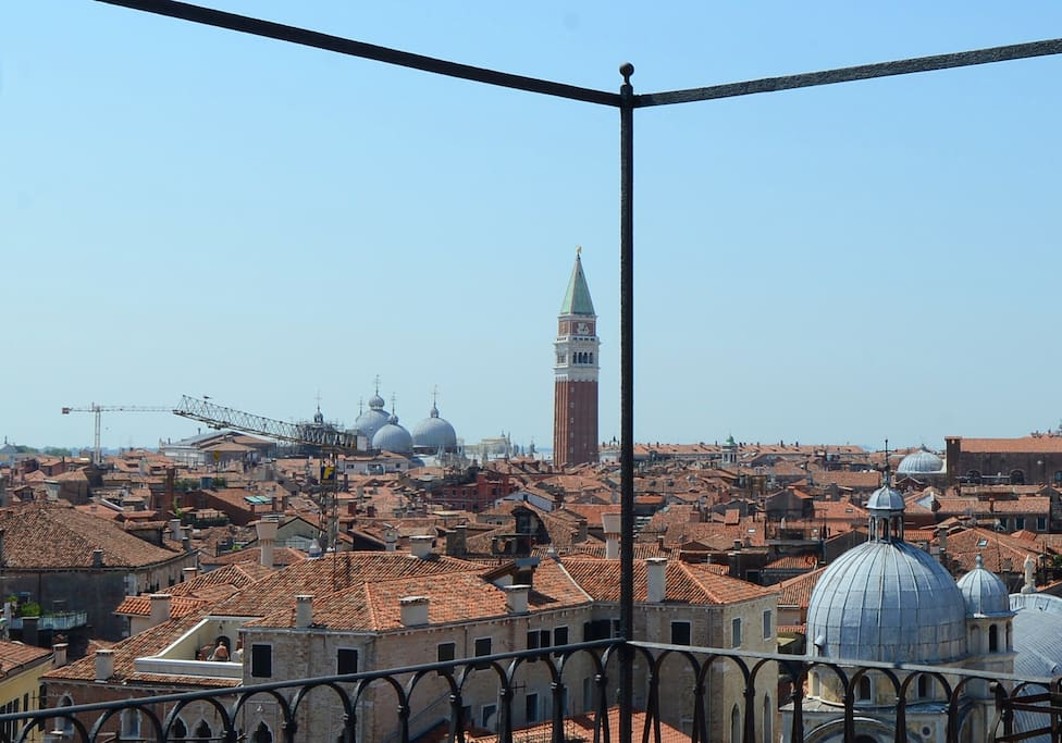 This is the view from the rooftop terrace, altana in the direction of San Marco. Santa Maria dei Miracoli's blue domes in the foreground.