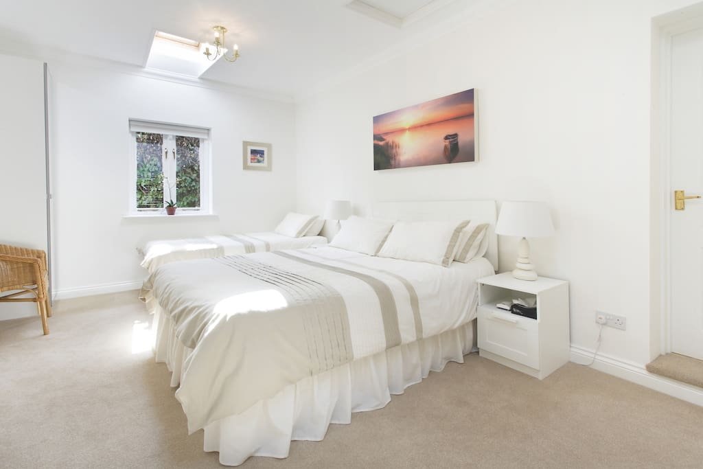 A king size and single bed suitable for up to three people