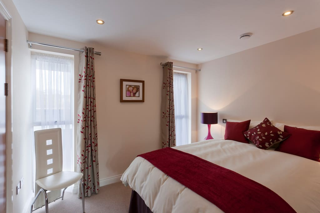Master bedroom which has an en-suite with a double sized shower......