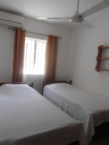 Seconde bedroom with 2 singles beds with aircon, ceiling fan