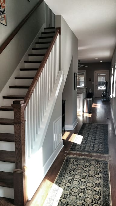 Welcome, come on in!  1st Floor has a bedroom with a Full bed, a full bathroom, a fully stocked kitchen, and a living/dining area, with access to the front porch, back porch, and a private-fenced in backyard and carport.