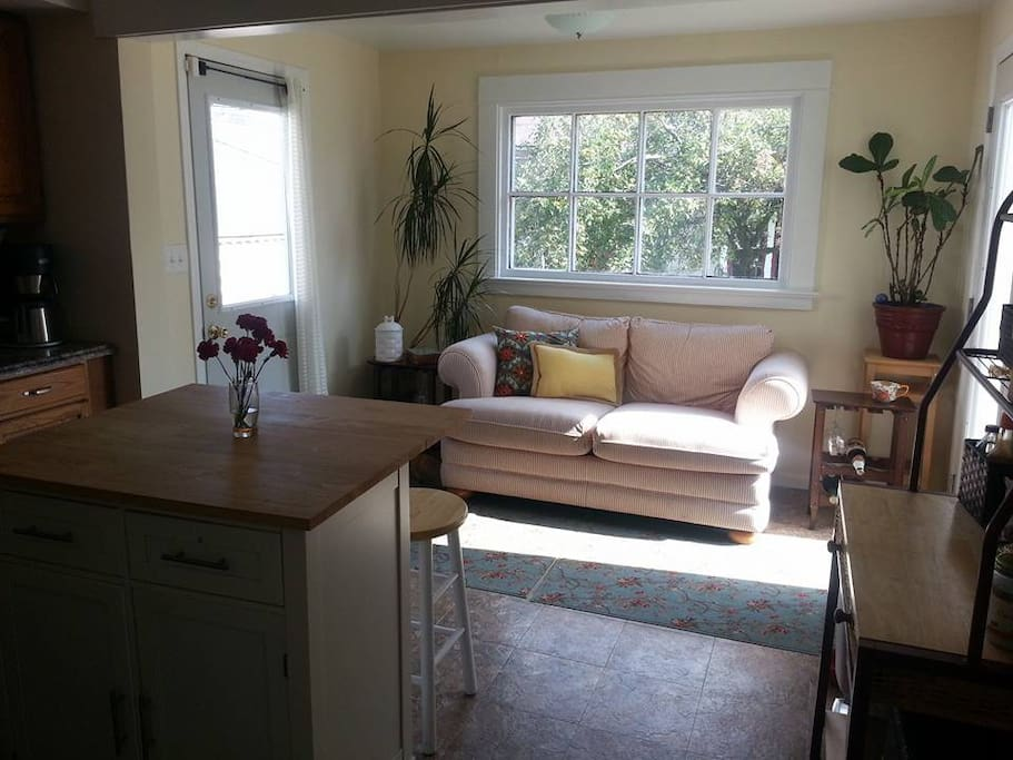 Kitchen with a couch for socializing while you cook!