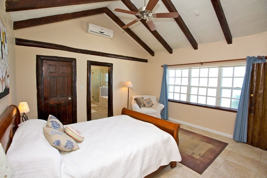 Master Bedroom with ensuite bathroom and Abaco pine beams